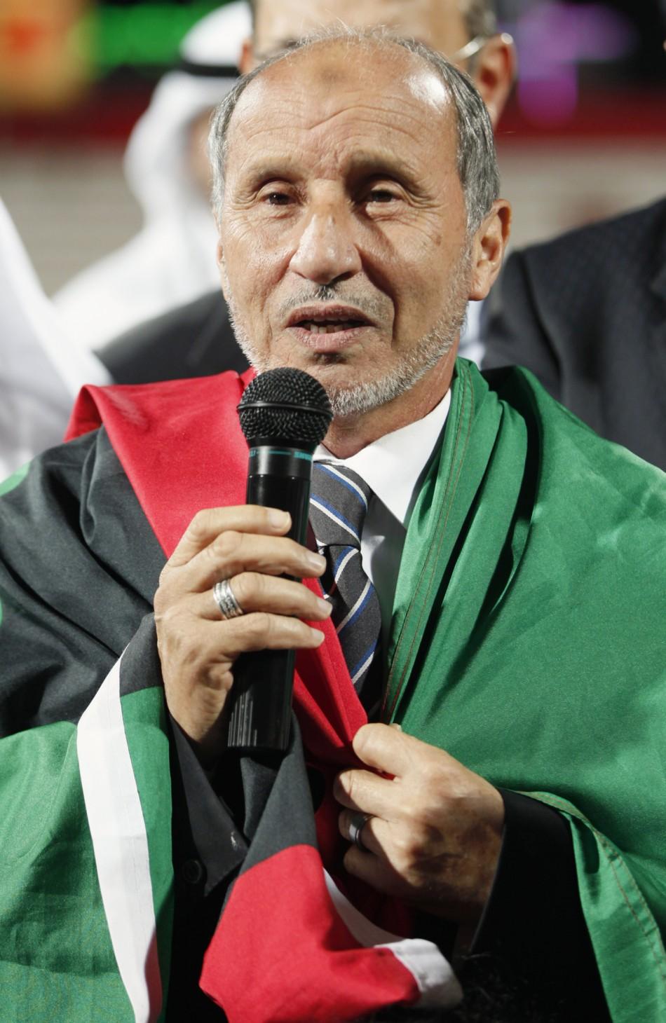 Libya's National Transitional Council Chairman Mustafa Abdul Jalil speaks during a charity football match in Dubai