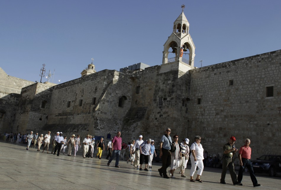 Holy Land tourists file past the Church of the Nativity, in the West Bank town of Bethlehem