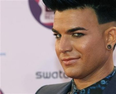 U.S. singer Adam Lambert poses on arrival on the red carpet at the MTV Europe Music Awards show in Belfast