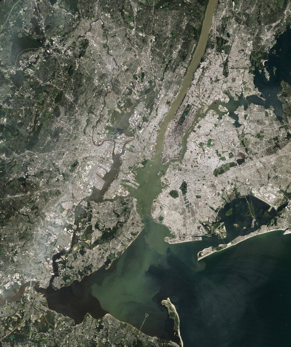 NASA satellite image shows sediment from Hurricane Irene rains and flooding emptying into New York Harbor from the Hudson River