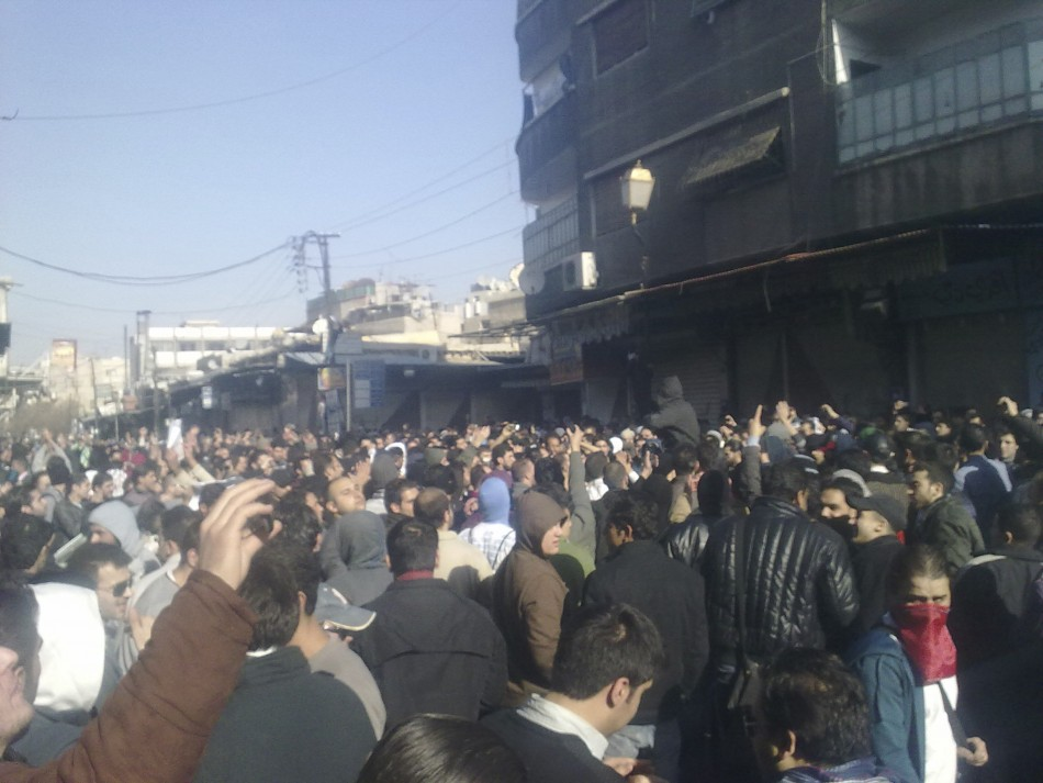 Demonstrators protest against Syria's President Bashar al-Assad in al-Midan district in Damascus