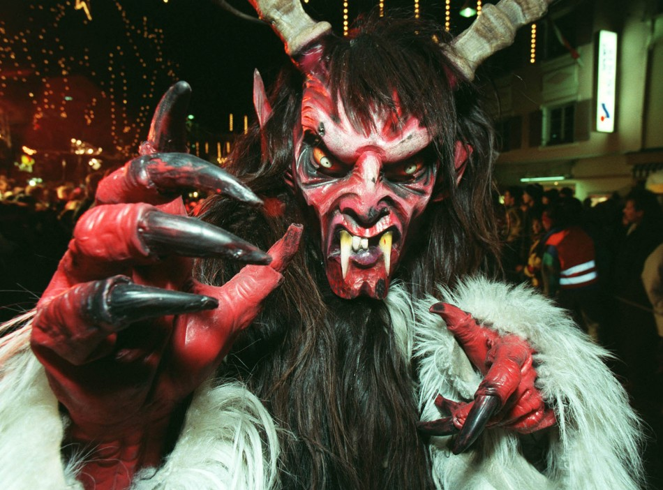 A man dressed in a costume of a Krampus, a traditional devil like figure