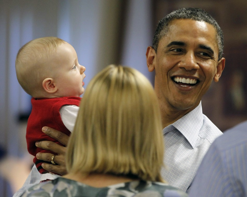 President Barack Obama with eight-month-old Cooper