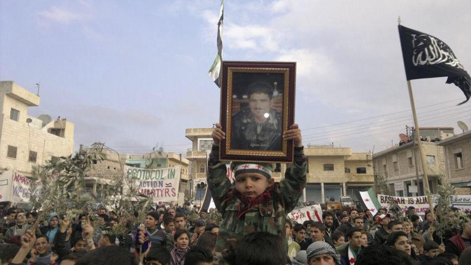 Demonstrators protest against Syria's President Assad after Friday prayers near Adlb