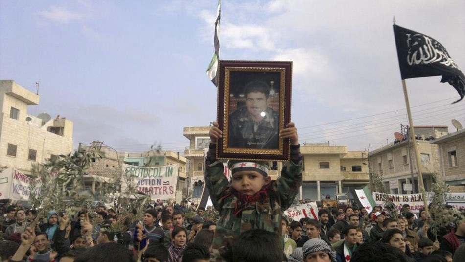 Demonstrators protest against Syria's President Assad after Friday prayers near Adlb