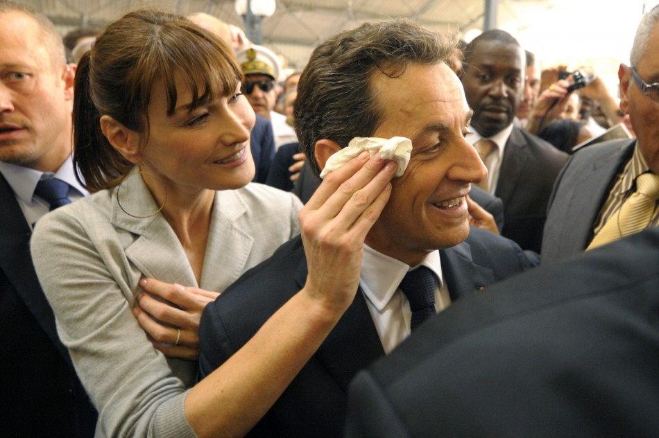 Carla Bruni-Sarkozy wipes the forehead of her husband, Frances President Sarkozy
