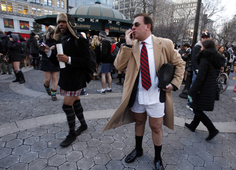 A man talks on his mobile during the 10th Annual No Pants Subway Ride in New York City