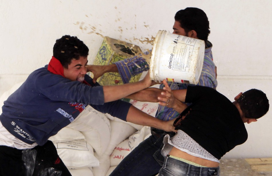 Two Copts scuffle with a man before the clashes between Coptic youths and riot police