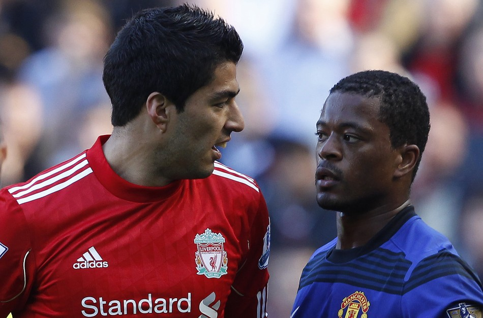 Evra and Suarez (REUTERS)