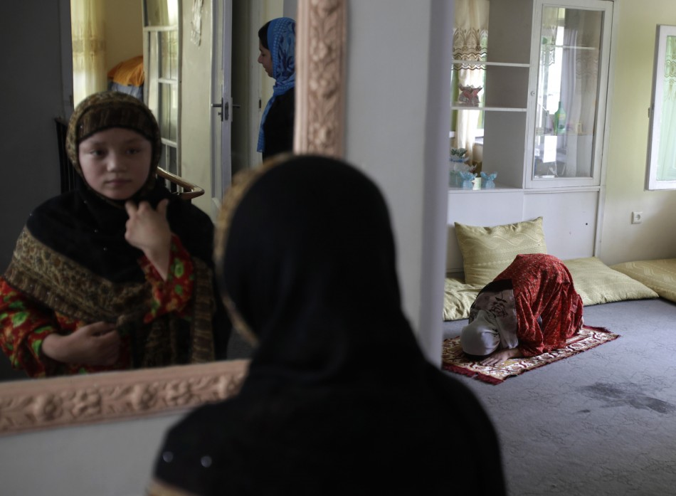 A woman prays at the Family Guidance Center in Kabul