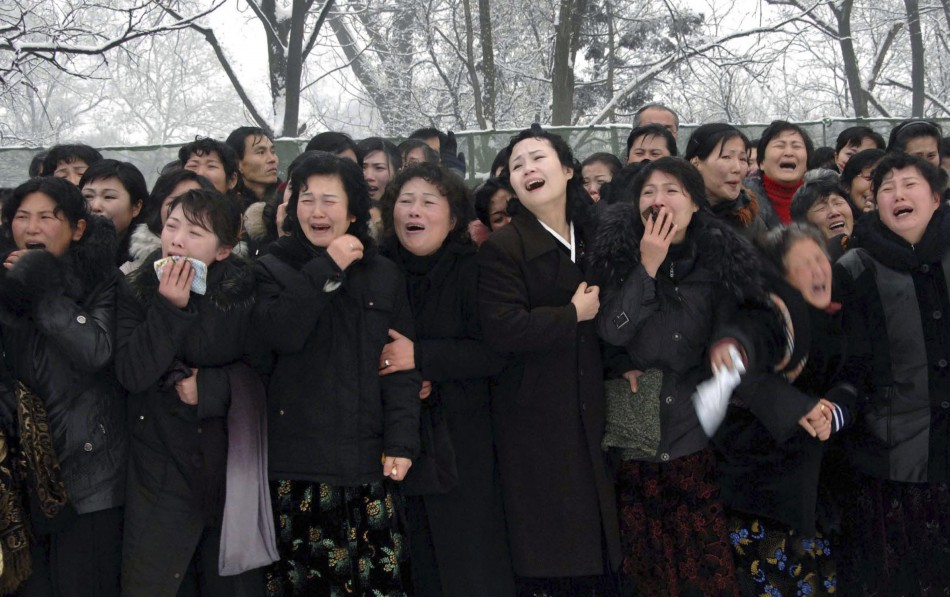 Crowds attend the funeral procession for late North Korean leader Kim Jong-il in Pyongyang