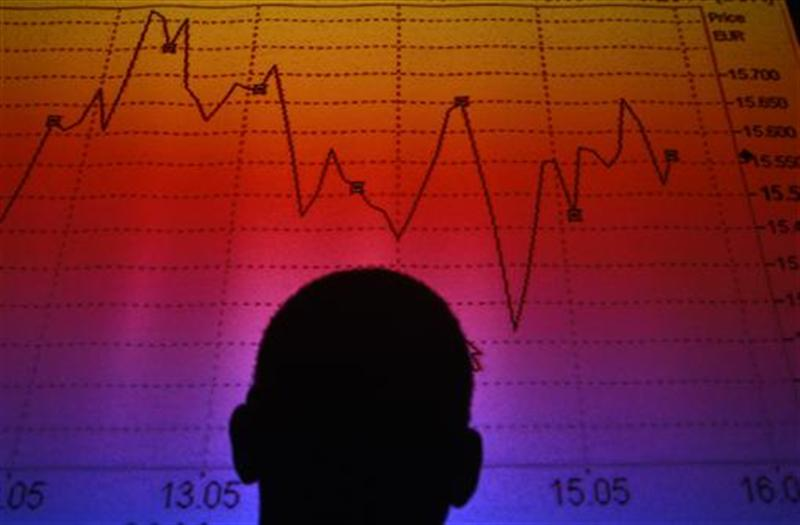 Photo illustration of man silhouetted in board showing Italian equity market index in Rome