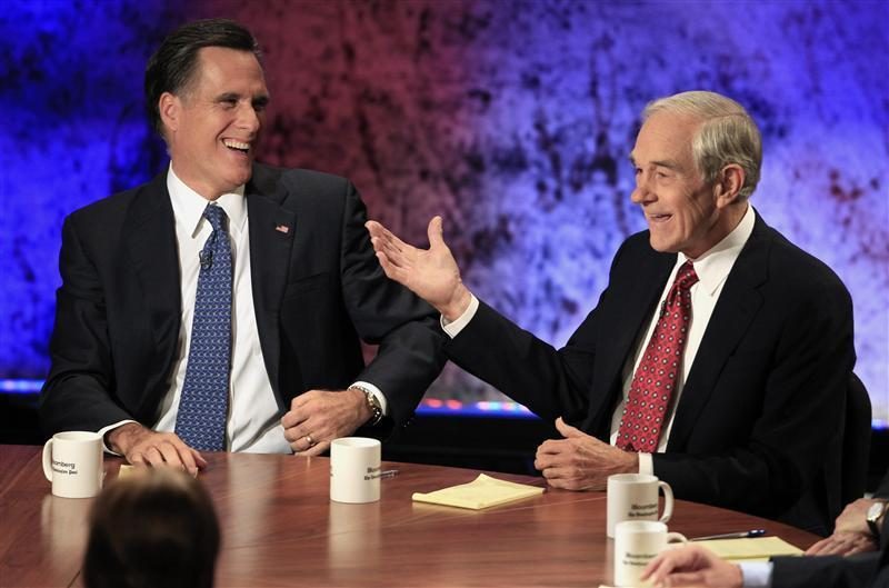 Mitt Romney (L) and Ron Paul
