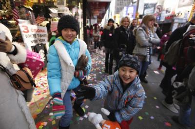 Children Play with Confetti