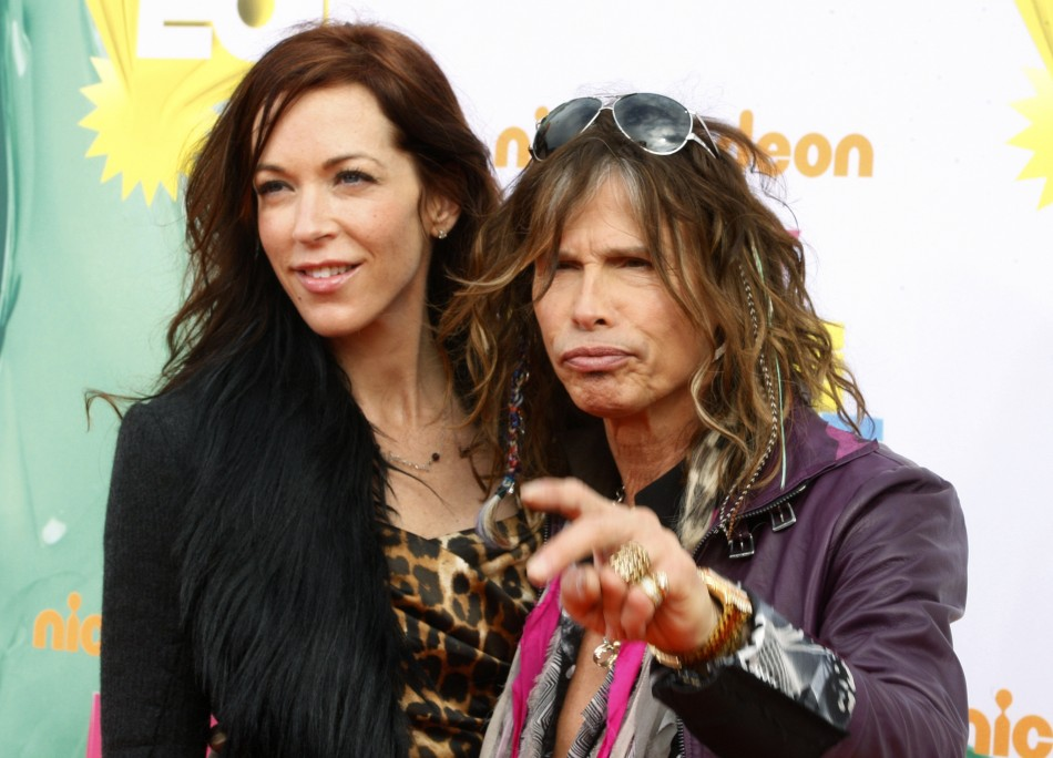 Singer Steven Tyler and Erin Brady pose at the 2011 Nickelodeon Kids Choice Awards in Los Angeles