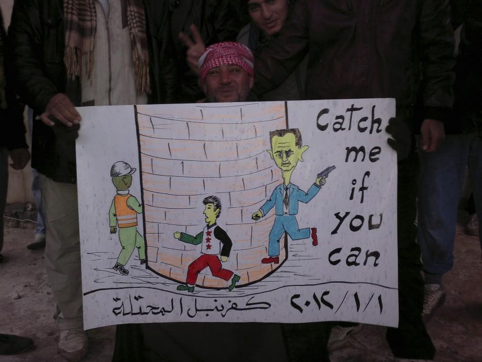Demonstrators protest against Syria's President Bashar al-Assad in Kafranbel
