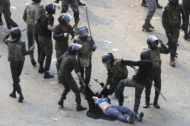 Egyptian army soldiers beat woman protester