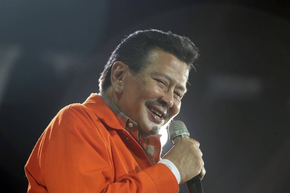 Philippine presidential candidate and ousted former president Joseph quotErapquot Estrada smiles at his final campaign rally at the University of Makati in Metro Manila