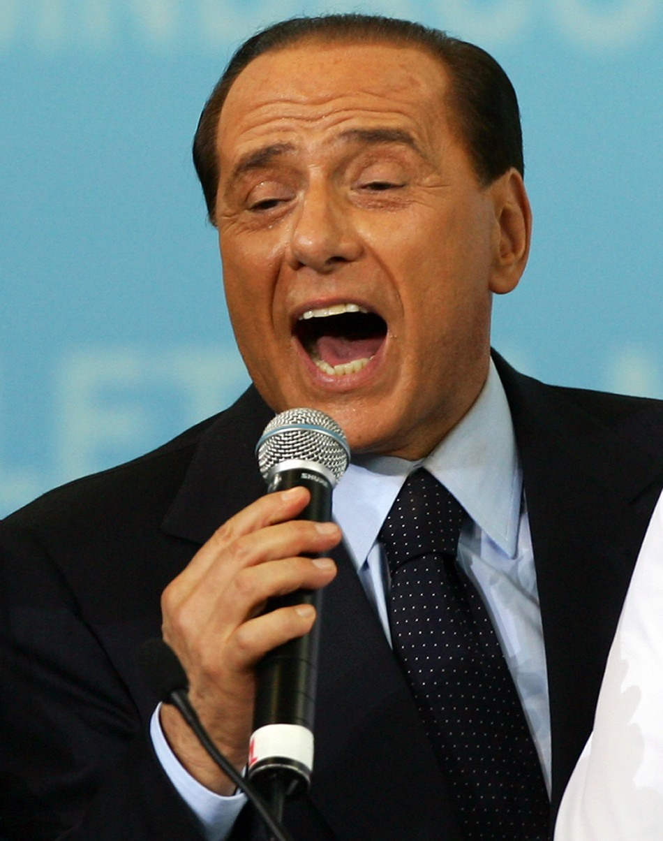 Italy's outgoing Prime Minister Berlusconi sings during opening of Letizia Moratti's electoral campign in Milan
