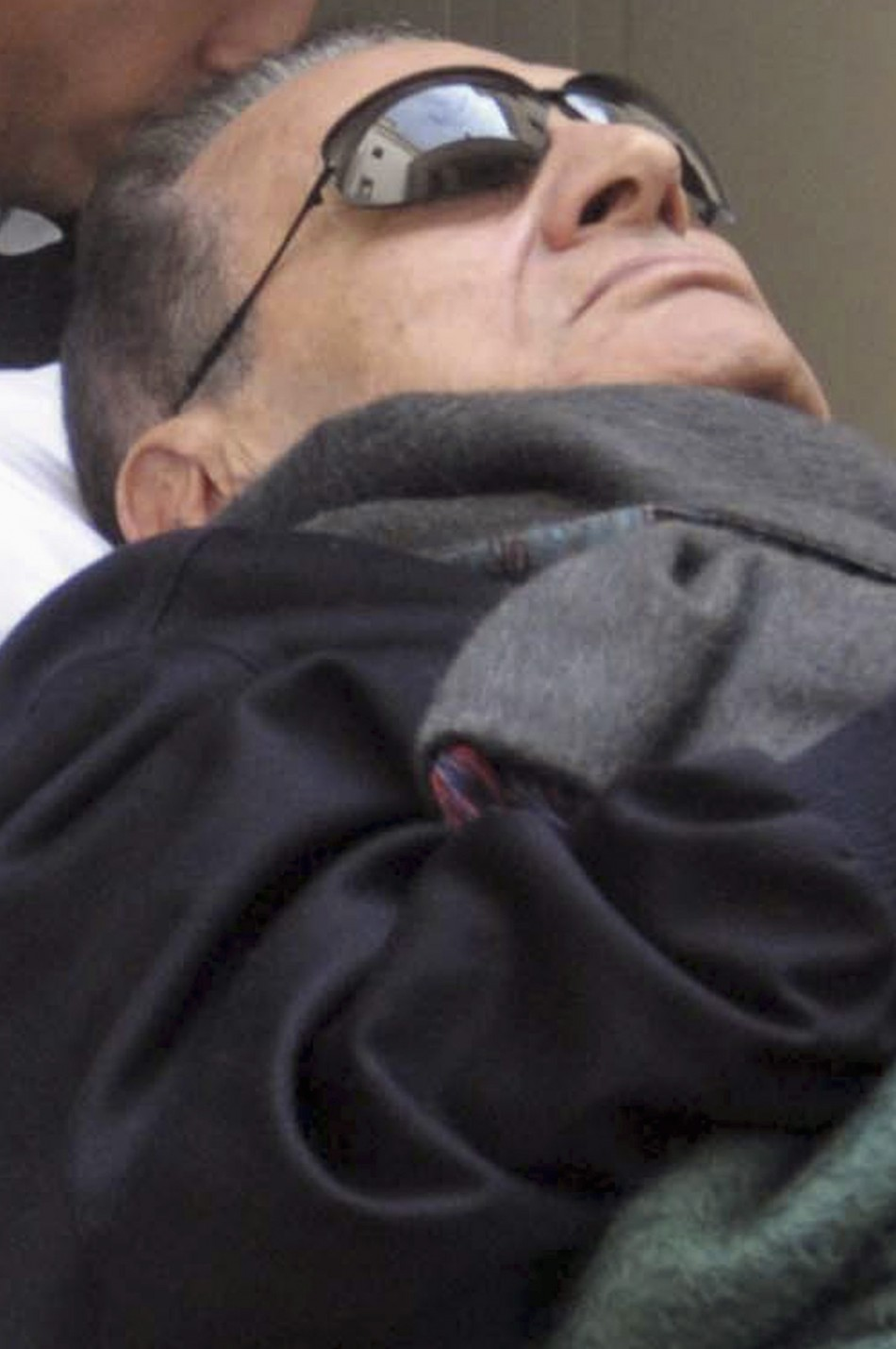 Former Egyptian President Mubarak Lies On A Gurney While Leaving The Courtroom