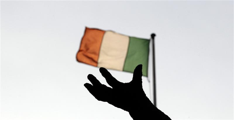 Ireland's national flag flies above a statue in Dublin