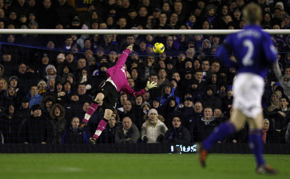 Everton's goalkeeper Tim Howard (unseen) scores past Bolton Wanderers' Adam Bogdan