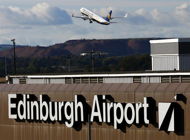 An passenger jet takes off from Edinburgh Airport in Scotland