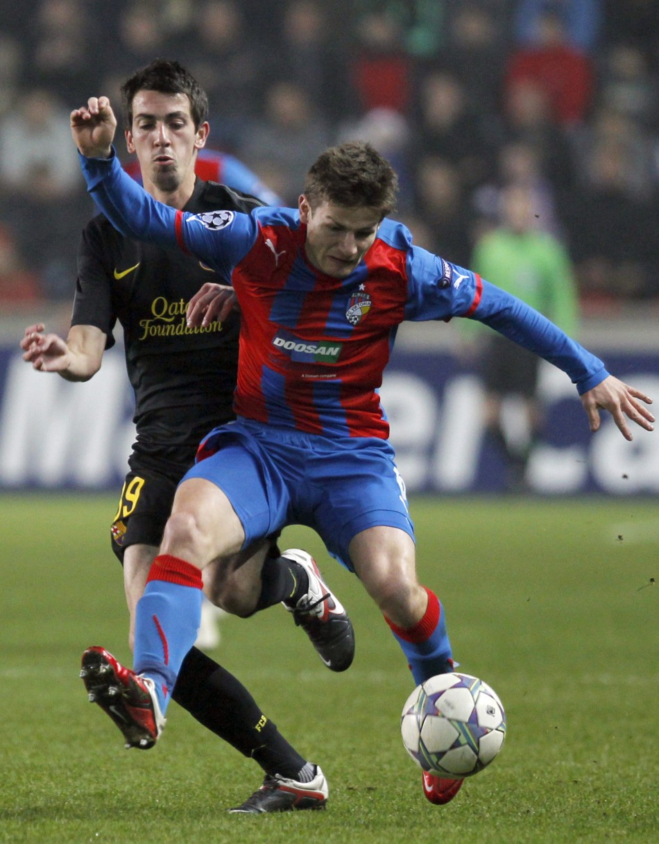 Barcelona's Cuenca is challenged by Pilar of Viktoria Plzen during their Champions League Group H soccer match in Prague
