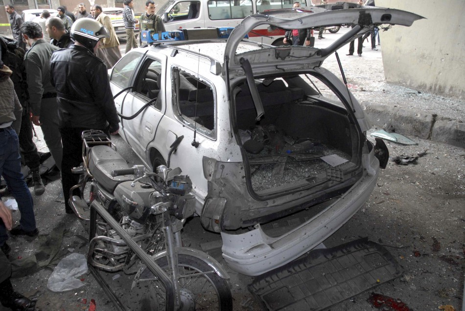 A car is damaged after an explosion in the Maidan district of Damascus
