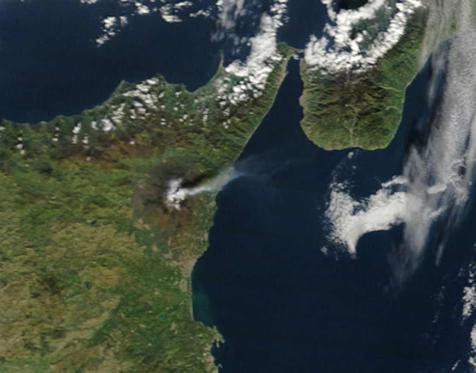 Italy's volcanic Mount Etna is seen spewing plumes of ash or steam from this image taken by the Moderate Resolution Imaging Spectroradiometer (MODIS) on NASA?s Terra satellite