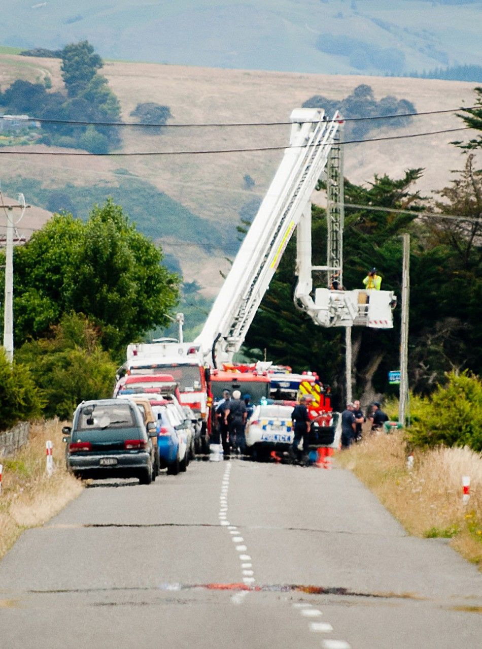 Hot Air Balloon Tragedy: A forensic photographer takes pictures at the scene of a hot air balloon crash near Caterton in New Zealand on 07/01/2012.