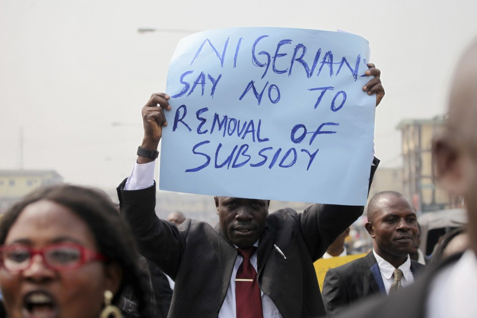 A member of the Nigerian Bar Association holds up a placard to protest a fuel subsidy removal in Lagos