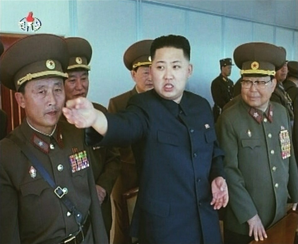 Kim Jong-un speaks while surrounded by soldiers