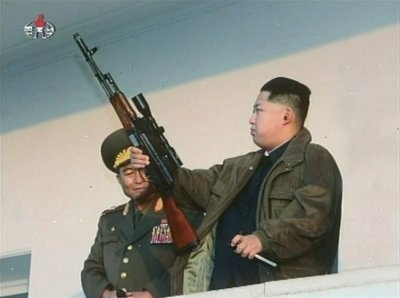 Kim Jon Ils sons Korea new leader  holds a weapon