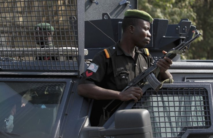 Police stand watch over protesters in Nigeria's capital, Abuja