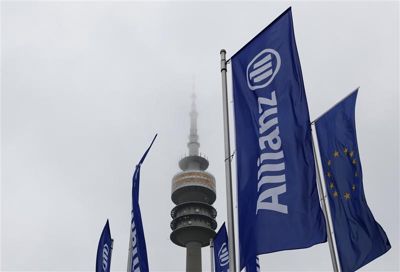 German insurer Allianz flags are seen in front of Munich's radio tower before shareholders' meeting