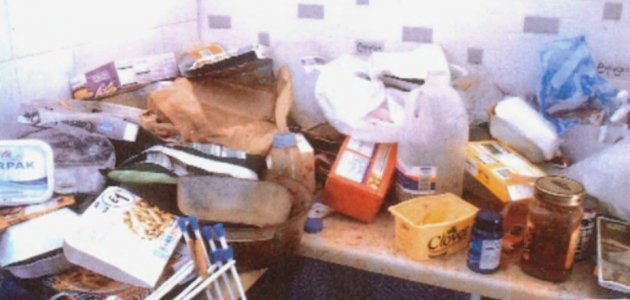Kitchen surfaces covered in containers of rotting food in Kimberly Hainey's flat