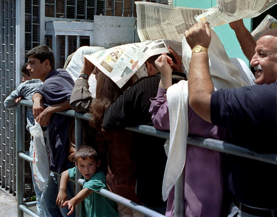 PALESTINIANS WAIT TO ENTER ISRAELI INTERIOR MINISTRY IN EAST JERUSALEM FOR PERMITS.