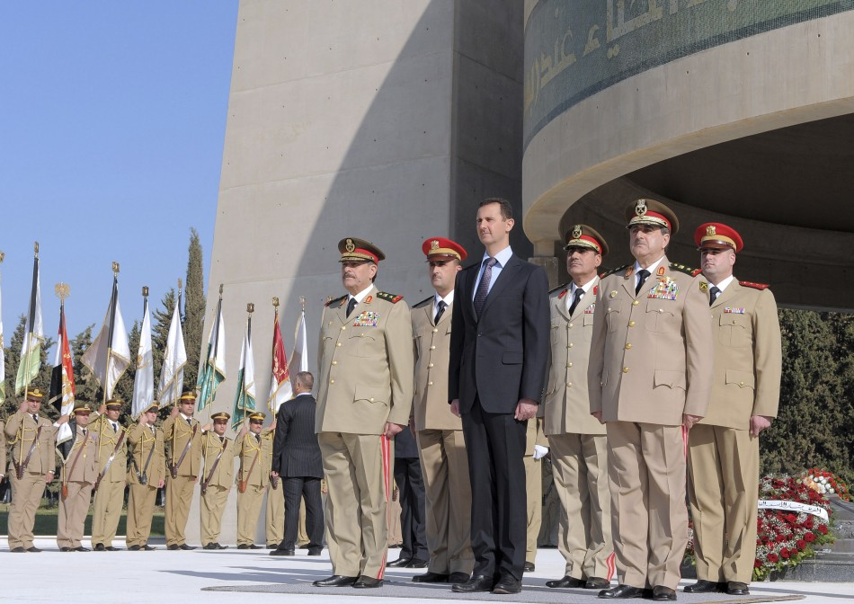 Syria's President Bashar al-Assad stands with leaders of the army