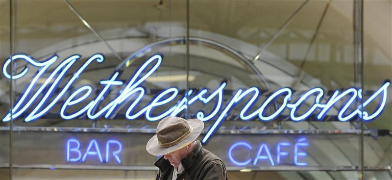 A Wetherspoon's logo is seen at a bar in central London