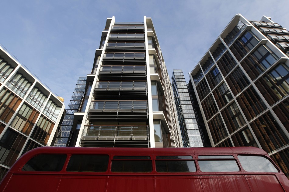 A Routemaster bus passes new development One Hyde Park in London ( Reuters)