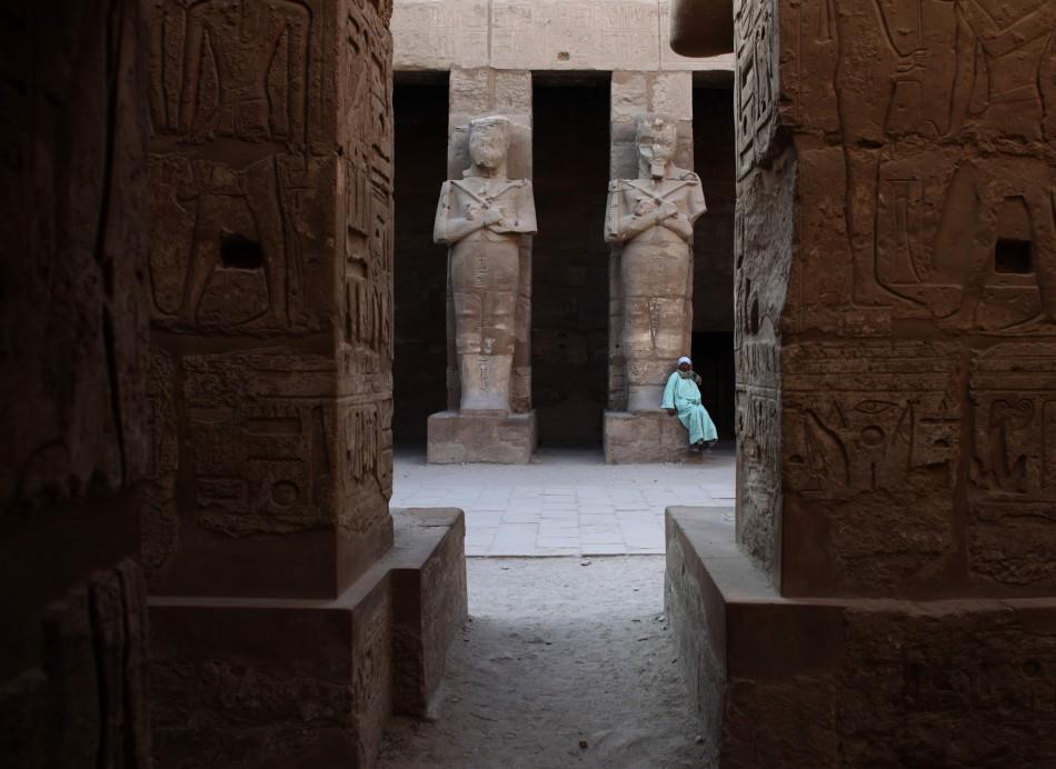 Temple guardian sits in Karnak Temple in Luxor