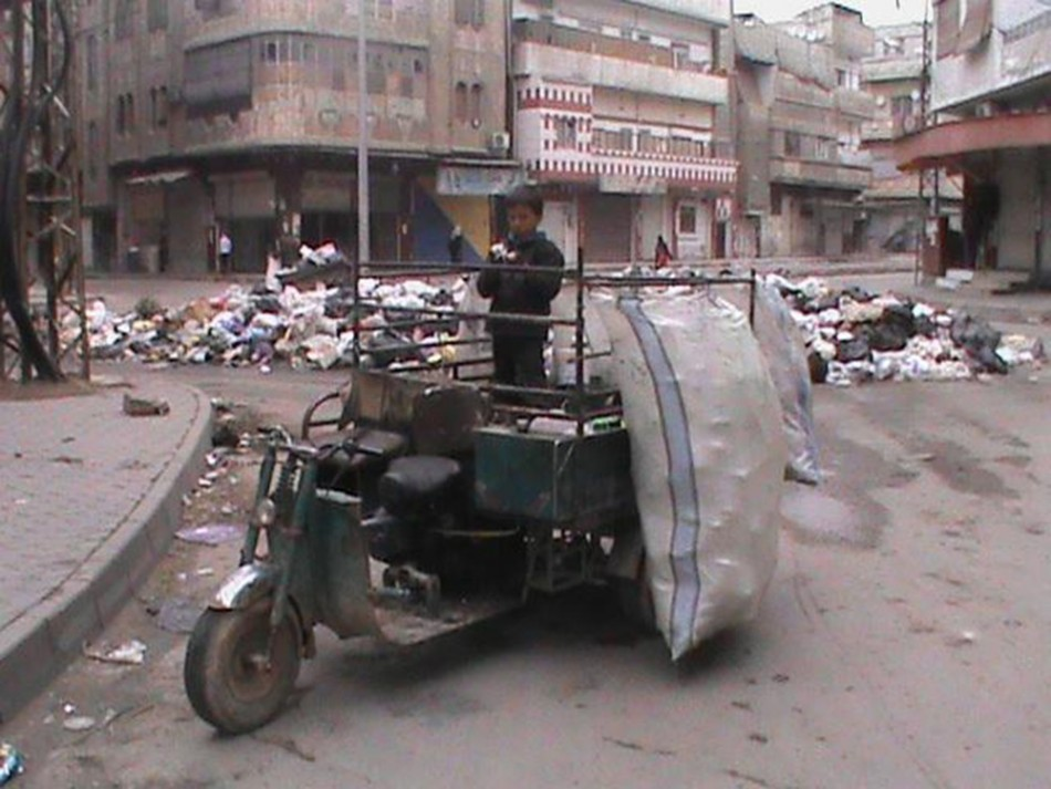Rubbish is piled up along a street in Marat al-Numan, Syria