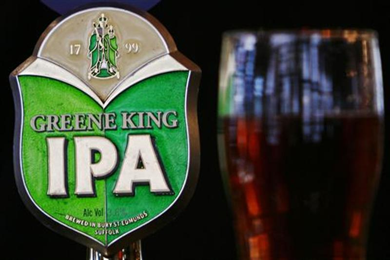 Greene King beer pump and pint of beer are seen in a pub in central London