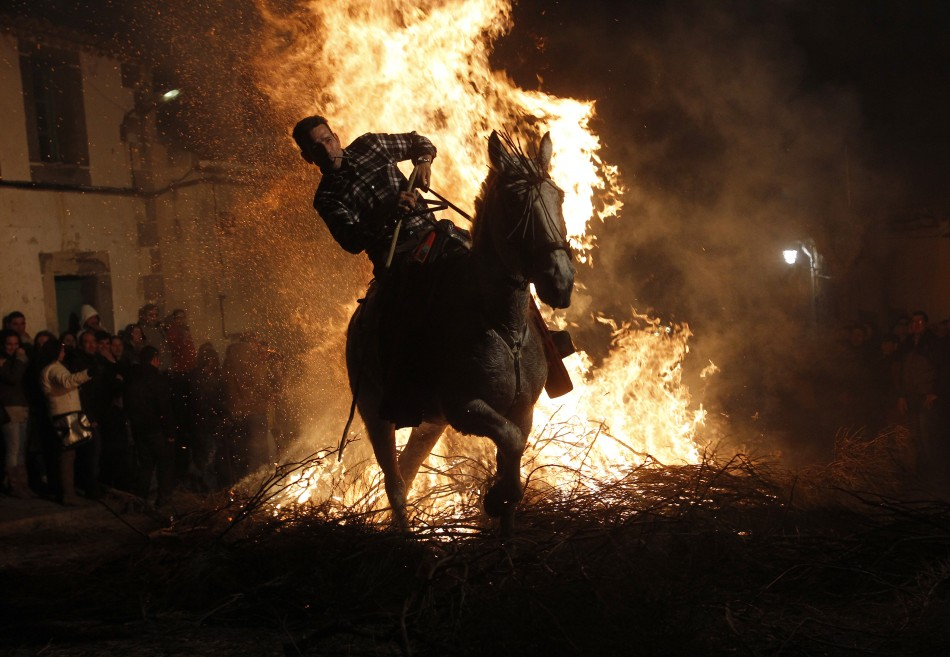 A man races through the flames during the annual Luminarias festival in Spain