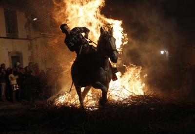 A man races through the flames during the annual Luminarias festival in Spain