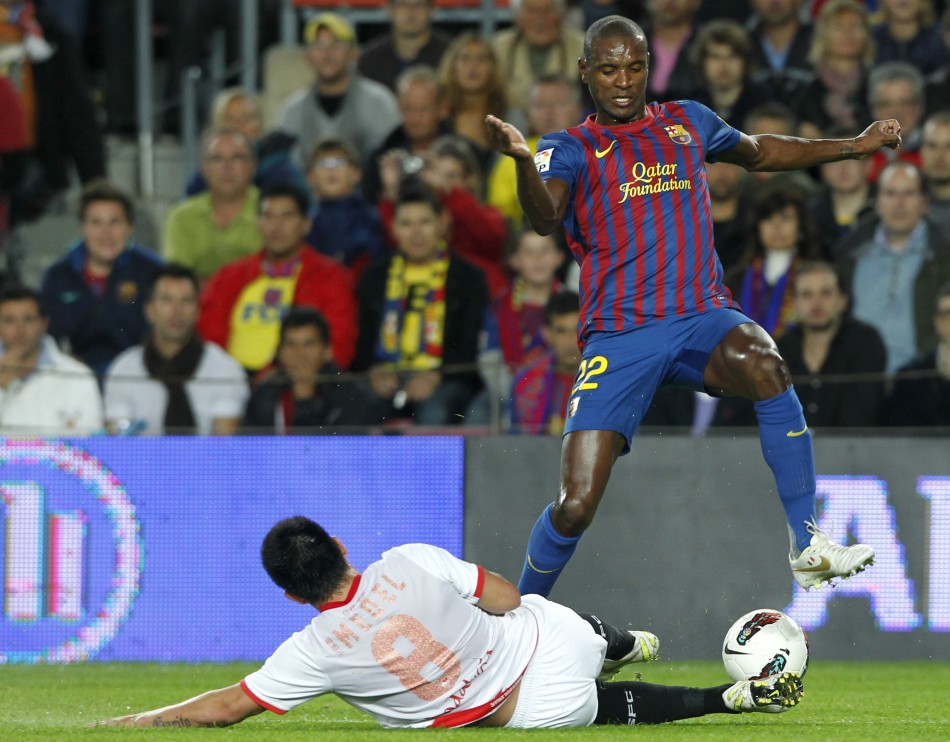 Barcelona's Eric Abidal is staying at the Nou Camp