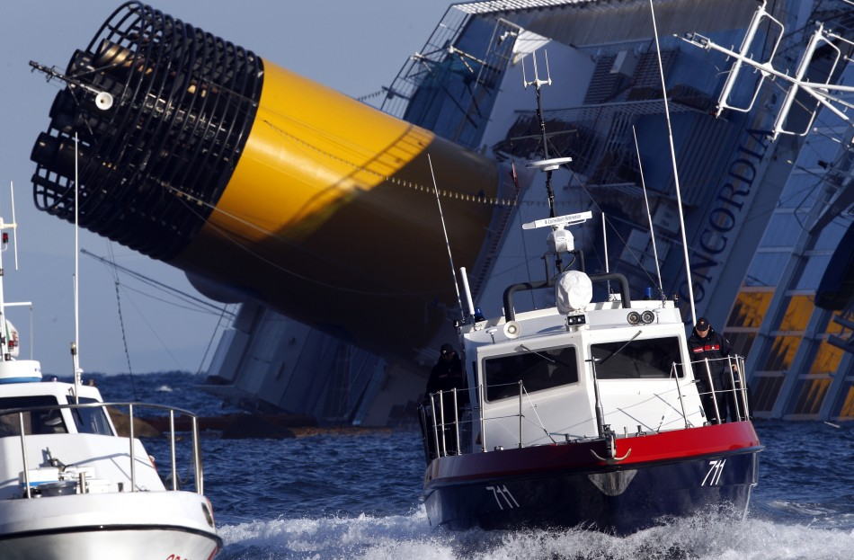 A boat with rescue workers is seen near the Costa Concordia cruise ship