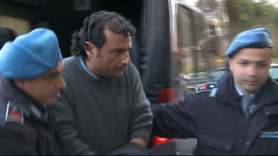 Captain Francesco Schettino of cruise ship Costa Concordia is escorted into a prison by police officers at Grosseto