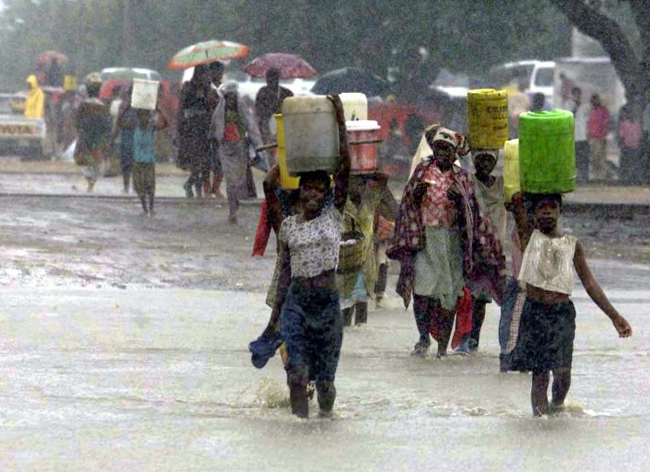 Mozambique villagers struggle through heavy rain in tropical depression Dando